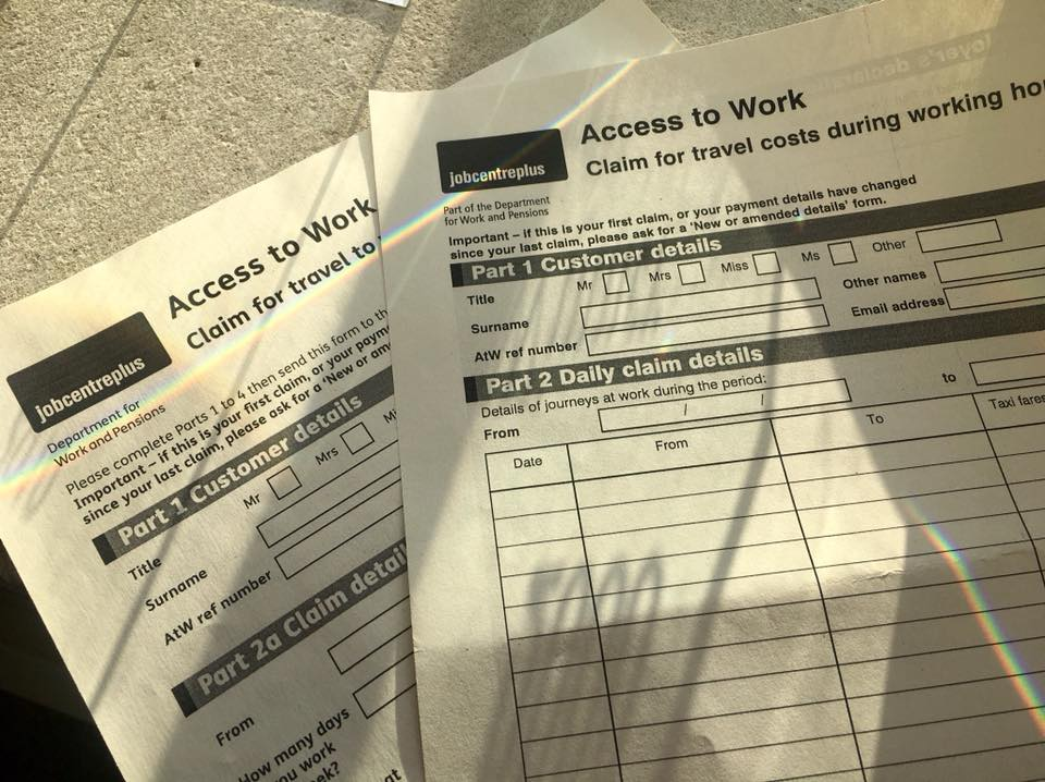 Two access to work document's on a table. One on top of the other.