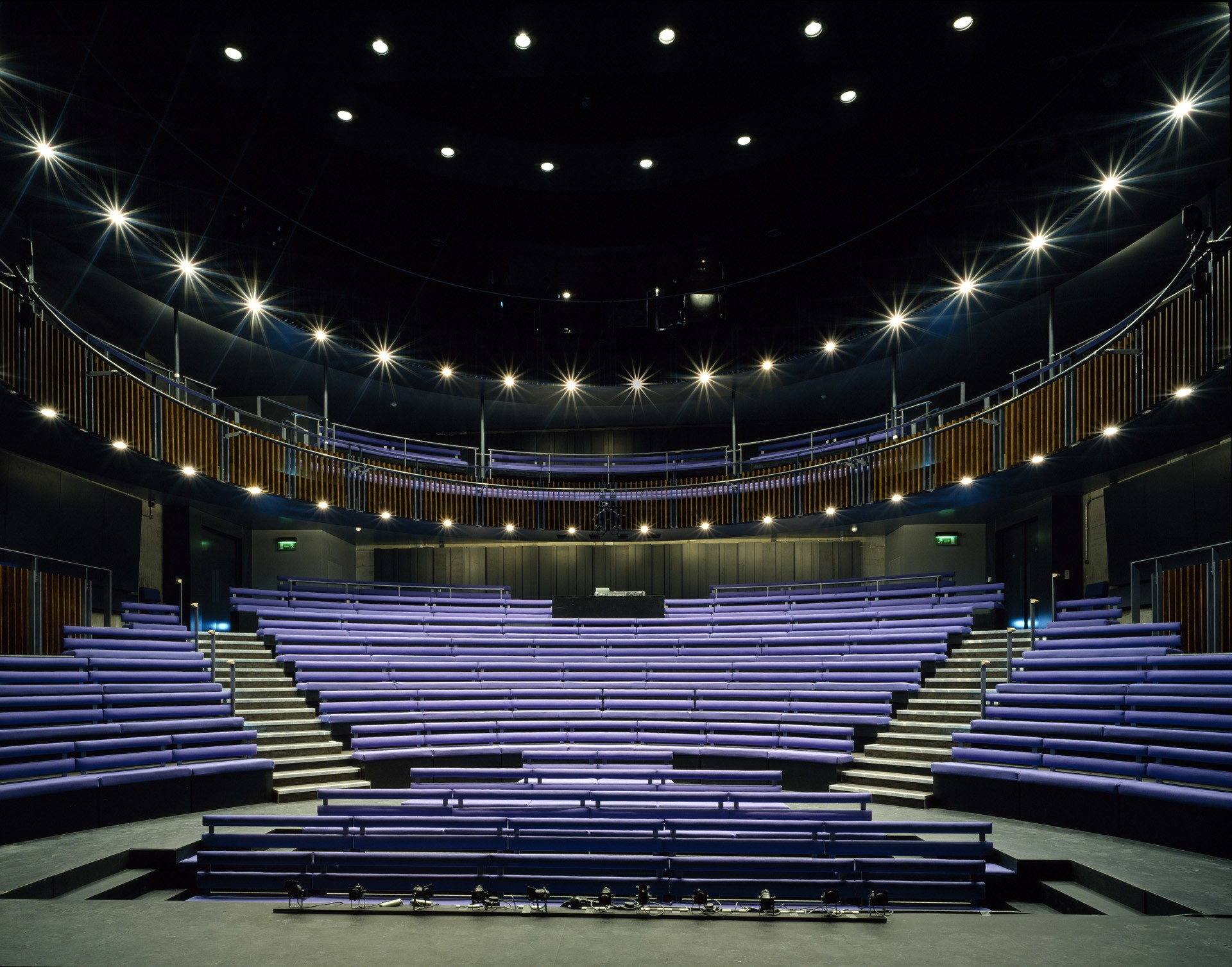 A large auditorium full of tiered seats. The inside of the Unicorn Theatre
