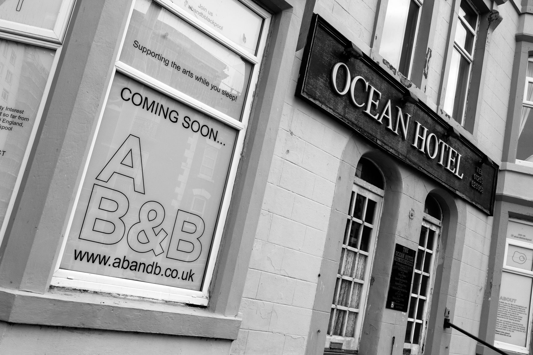 Picture of a shop in black and white, the shop is named ocean hotel