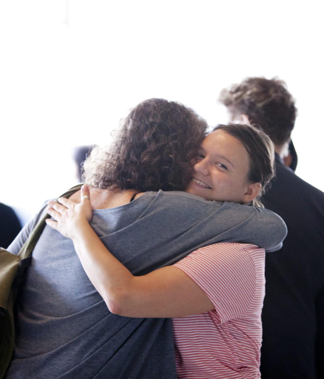 Clara hugging an artist